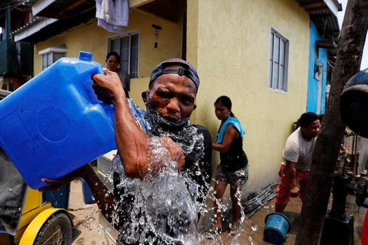 Ảnh: Cảnh tượng đau lòng trong những khu ổ chuột bị thiêu rụi ở Philippines - Ảnh 14.