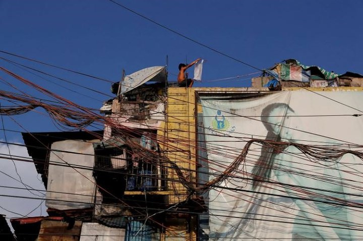 Ảnh: Cảnh tượng đau lòng trong những khu ổ chuột bị thiêu rụi ở Philippines - Ảnh 3.