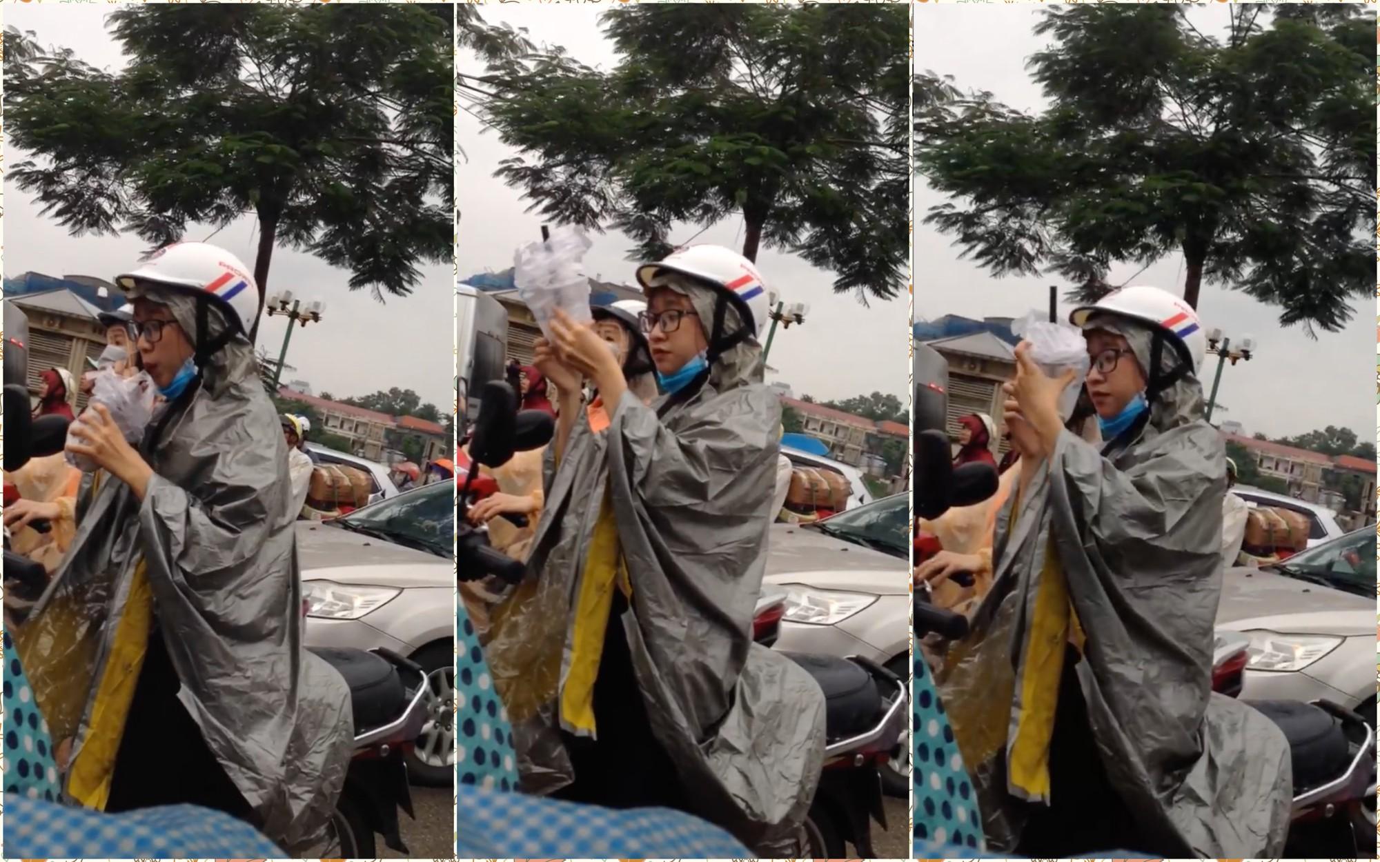 Clip Cô gái uống trà sữa ngon lành dưới cơn mưa và đường tắc làm sáng bừng lên một ngày ảm đạm - Ảnh 2.