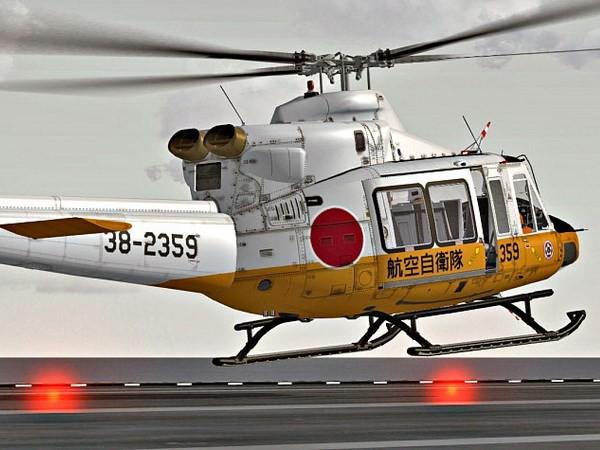 Trực thăng cứu hộ chở chín người mất tích tại Nhật Bản - Ảnh 1.