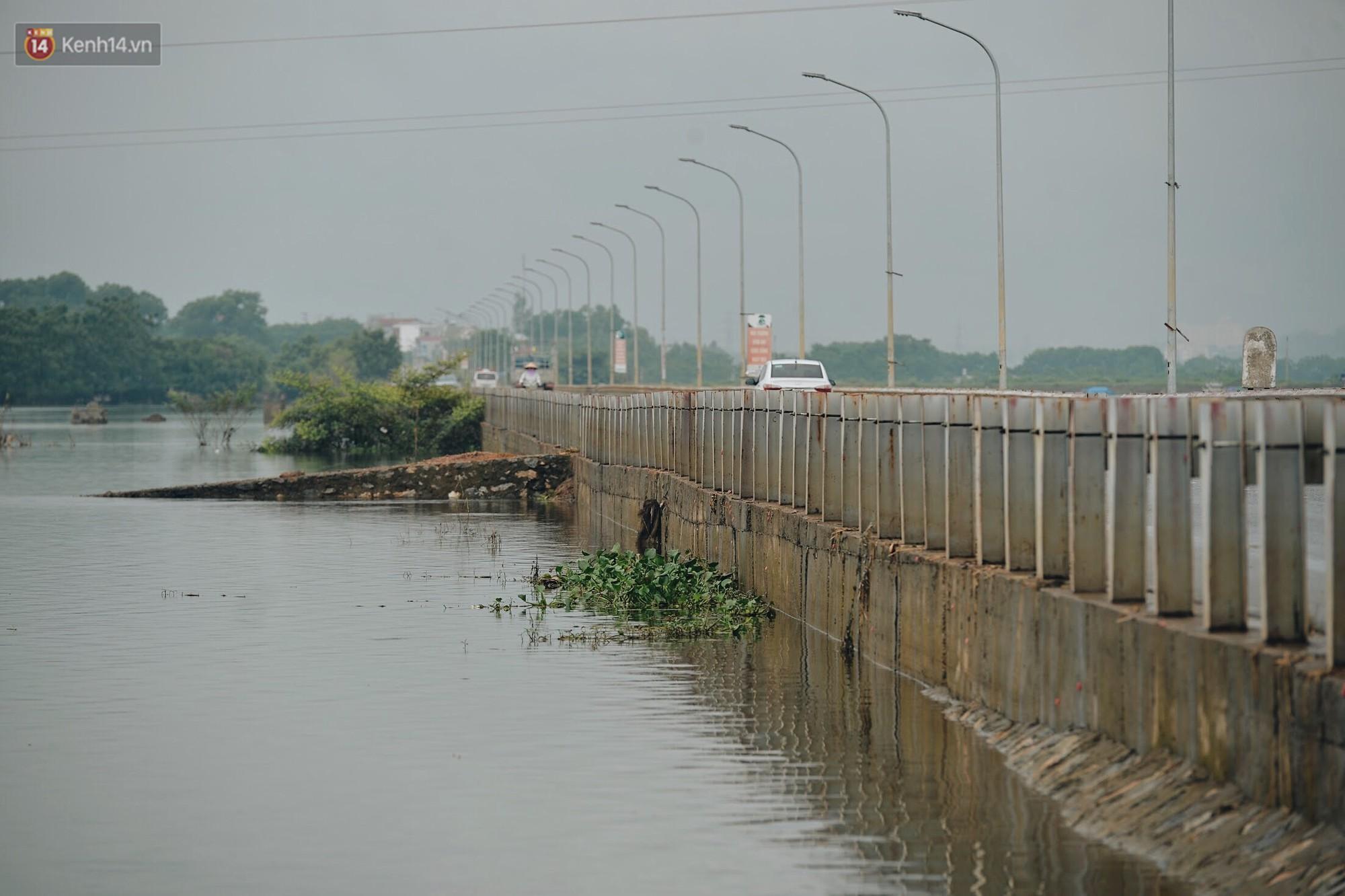 Con đường tỉnh lộ nơi hàng trăm người bơi lội ở Hà Nội sau nửa tháng chìm trong biển nước đã thông xe trở lại - Ảnh 9.