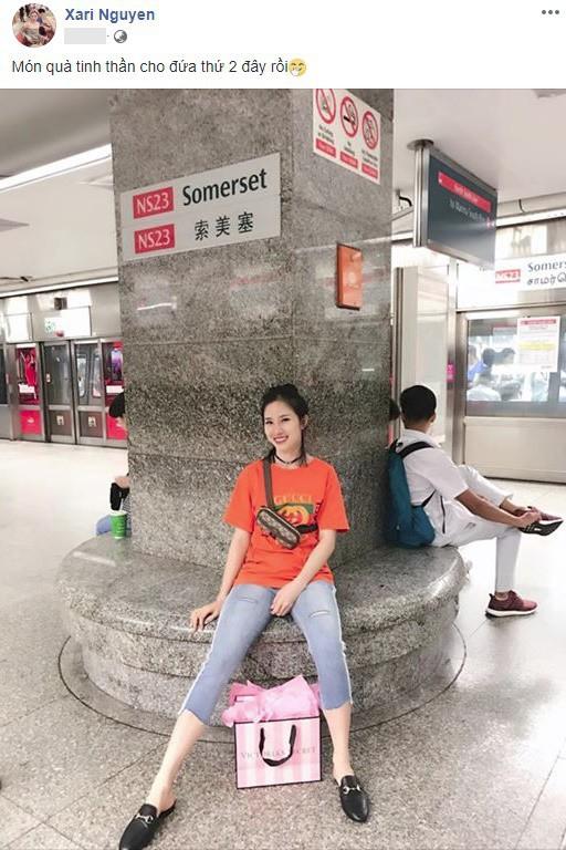 Xari Nguyễn - vợ hai Đăng Nguyên khoe ảnh đi chơi ở Singapore, úp mở chuyện có bầu lần 2 - Ảnh 1.