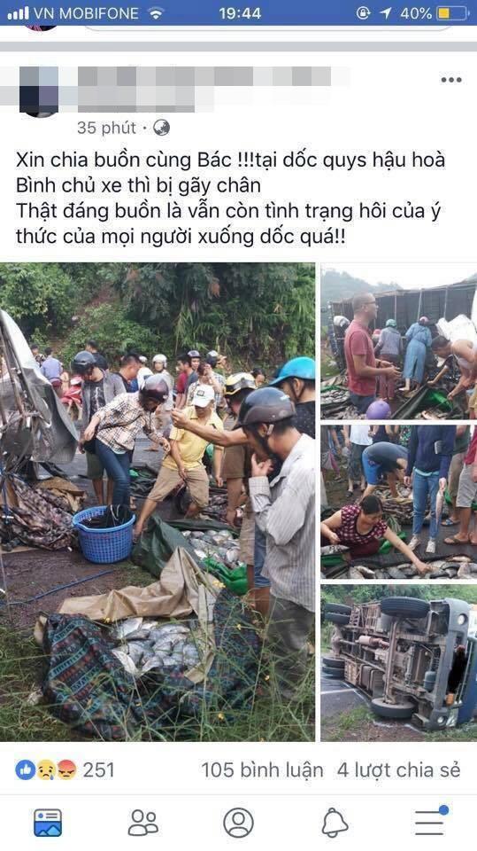 Xe tải chở cá bị lật, nhiều người dân Hòa Bình giúp đỡ thu gom cá vương vãi trên đường rồi mua ủng hộ tài xế - Ảnh 1.