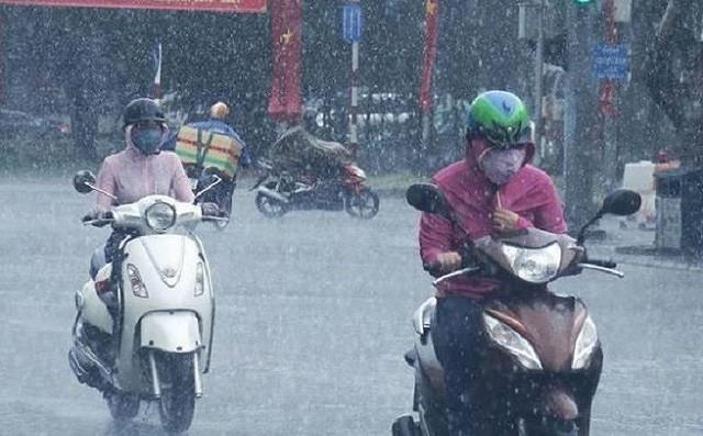 Không khí lạnh tràn về, Hà Nội mưa rào ngày tiễn đưa Chủ tịch nước Trần Đại Quang - Ảnh 1.