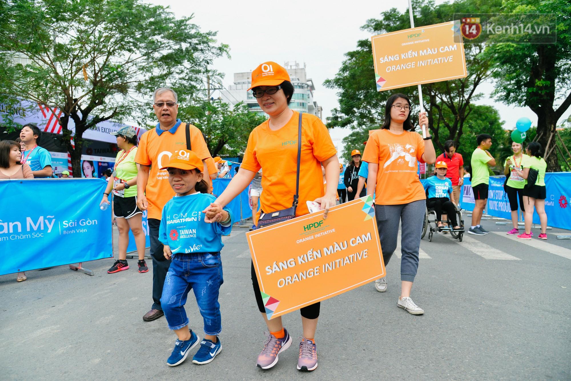 Đường đua 5km và câu chuyện vượt lên chính mình của những người khuyết tật ở Sài Gòn - Ảnh 2.