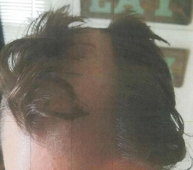Thợ cắt tóc bị cảnh sát tóm cổ vì cạo đầu khách hàng - Ảnh 1.
