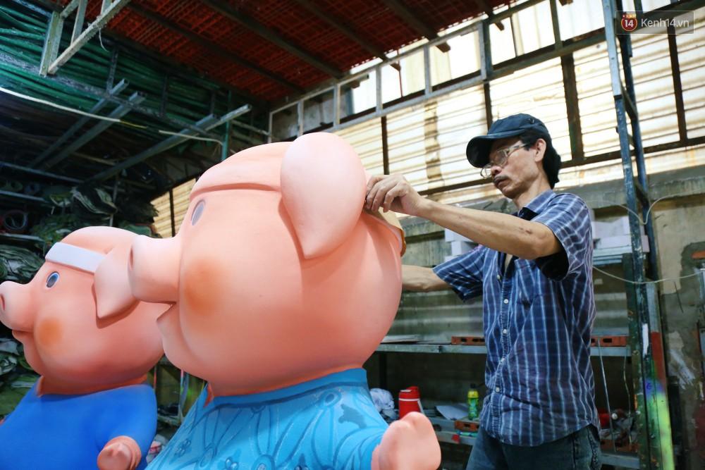 Ngắm 50 chú heo mập đáng yêu sắp được ra đường hoa Nguyễn Huệ đón Tết Kỷ Hợi 2019 - Ảnh 3.