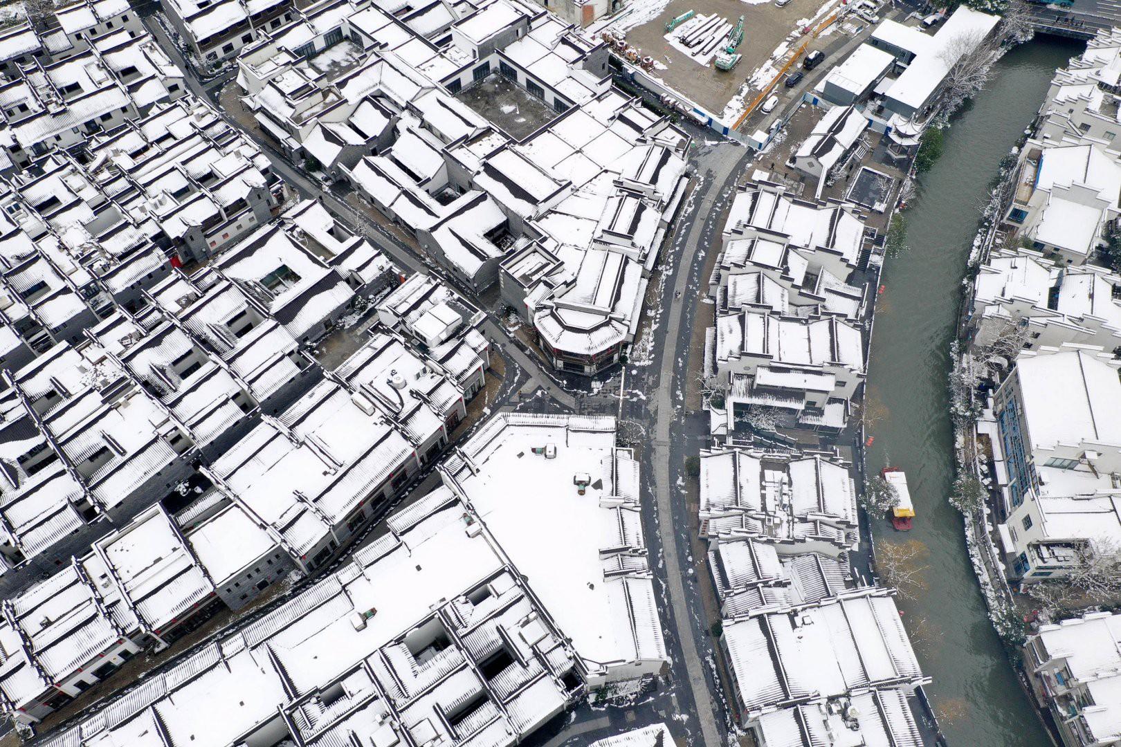 Vẻ đẹp trong trẻo của tuyết mùa xuân ở Trung Quốc khiến nhiều tín đồ du lịch cuồng chân dù đã hết Tết - Ảnh 9.