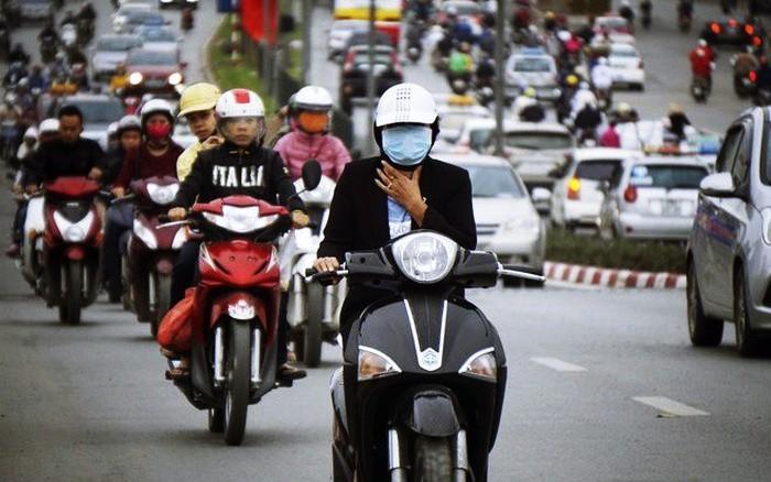Không khí lạnh tràn về trong ngày đầu tiên đi làm sau nghỉ Tết, Hà Nội giảm nhiệt - Ảnh 1.