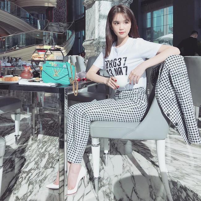 Street style cận Tết của sao Việt: Hà Hồ diện toàn màu chóe, Đàm Thu Trang cực giản dị trong bộ đồ sắc nâu - Ảnh 6.
