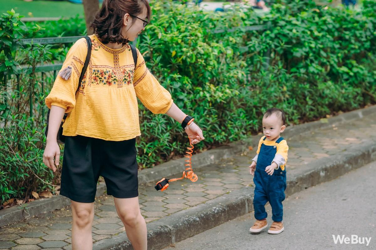 Những bà mẹ bị hội chứng mất não sau sinh nhất định phải thử qua sợi dây chống lạc con nơi công cộng này - Ảnh 9.