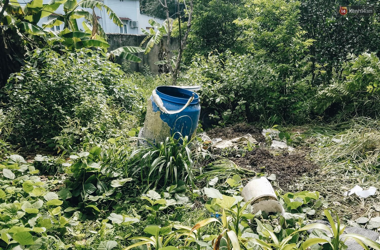 Mùi hôi nồng nặc bên trong căn nhà nơi phát hiện 2 khối bê tông chứa thi thể người ở Bình Dương - Ảnh 13.