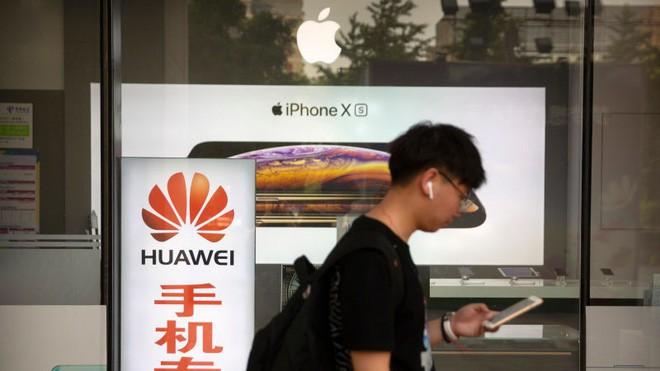 """Trung Quốc cảnh báo đối thủ: Microsoft, Dell, Samsung... sẽ gặp """"hậu quả thảm khốc"""" nếu theo Mỹ - Ảnh 1."""