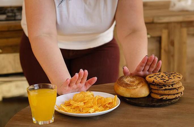 VZN News: Nguyên nhân bất ngờ khiến nhiều người ăn ít vẫn mập - Ảnh 1.