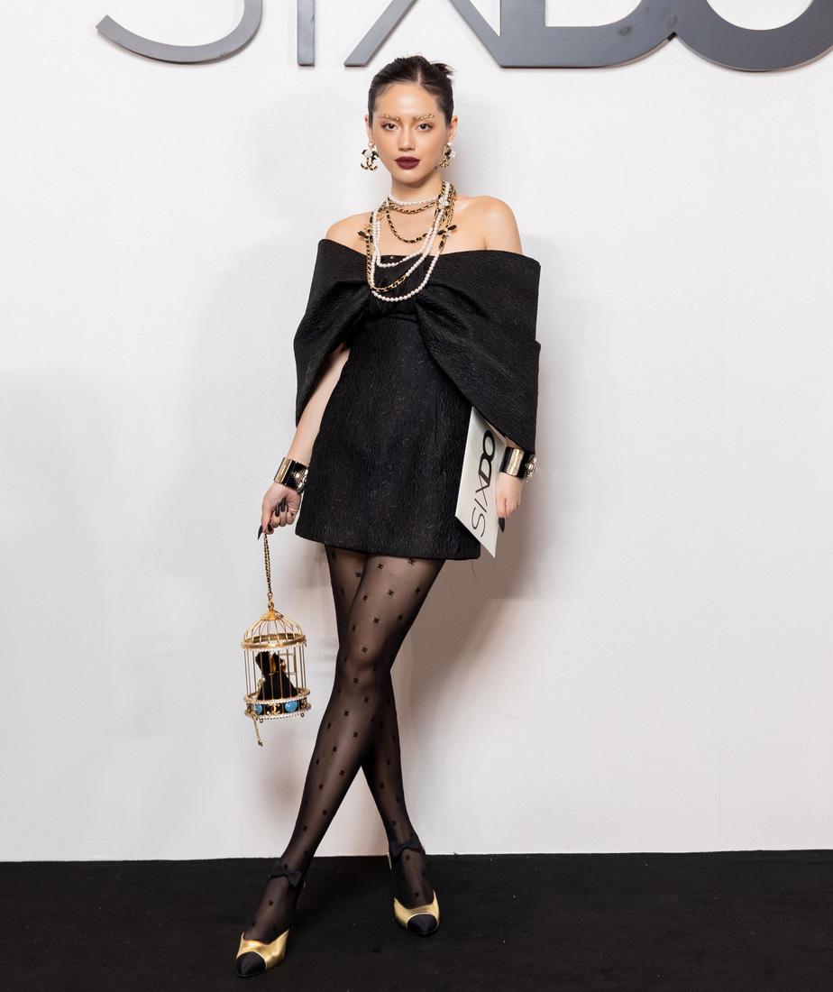 Angela Phương Trinh comeback chặt đẹp dàn mỹ nhân, Khánh Linh đã dát vàng lông mày còn xách túi lồng chim nửa tỷ - Ảnh 2.
