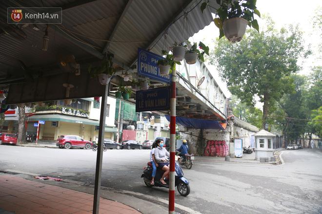 Ngắm nhịp sống trầm lặng trên những con phố siêu ngắn ở Hà Nội mùa dịch Covid -19 - ảnh 18