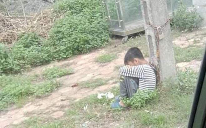 Lạng Sơn: Cha xích cổ con vào cột điện ven đường vì... con lười học? - ảnh 1