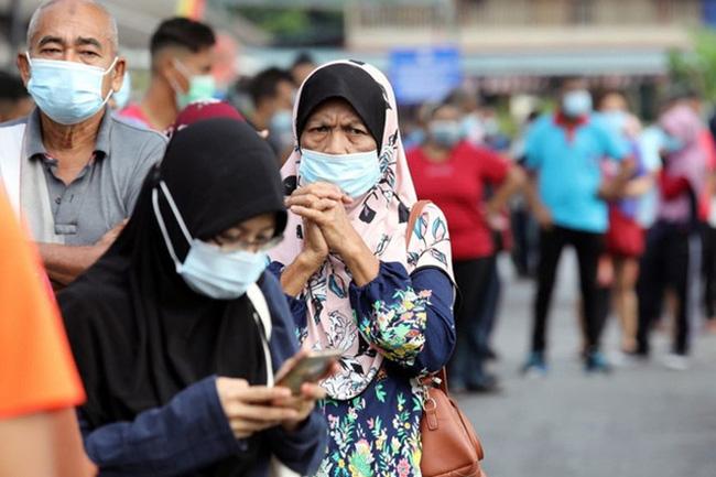 Malaysia bắt đầu hạn chế đi lại toàn quốc - ảnh 1