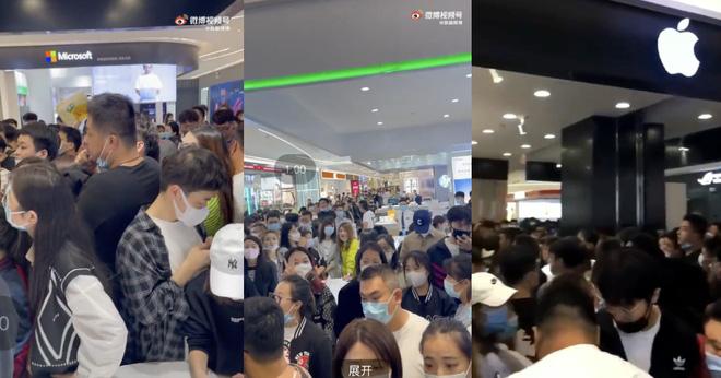 Đám đông hỗn loạn chen nhau để được xếp hàng mua iPhone 13 ở Trung Quốc - ảnh 3