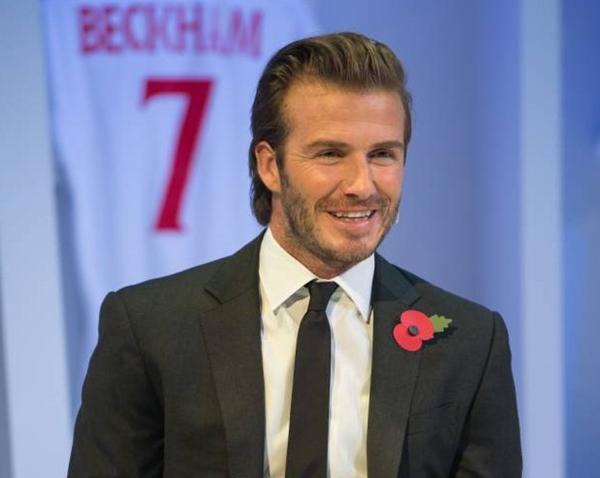 """Vợ chồng Beckham bị chê """"nhàm chán"""" và có nụ cười như """"đi mượn"""" 1"""
