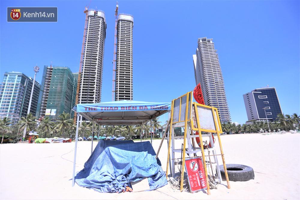 Toàn cảnh Đà Nẵng ngày đầu cách ly xã hội: Bãi biển không bóng người, bến xe dừng hoạt động - Ảnh 20.