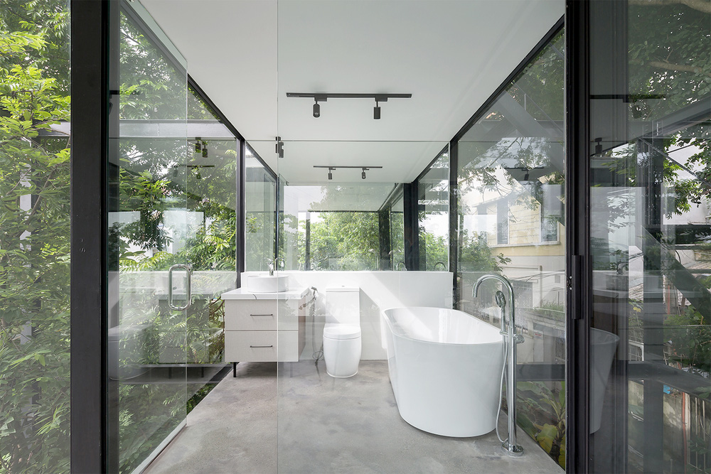 Ngôi nhà trong suốt bên bờ sông Đuống: Thay 75% tường bằng vách kính nhưng vẫn mát mẻ nhờ 3 thiết kế đặc biệt - Ảnh 8.