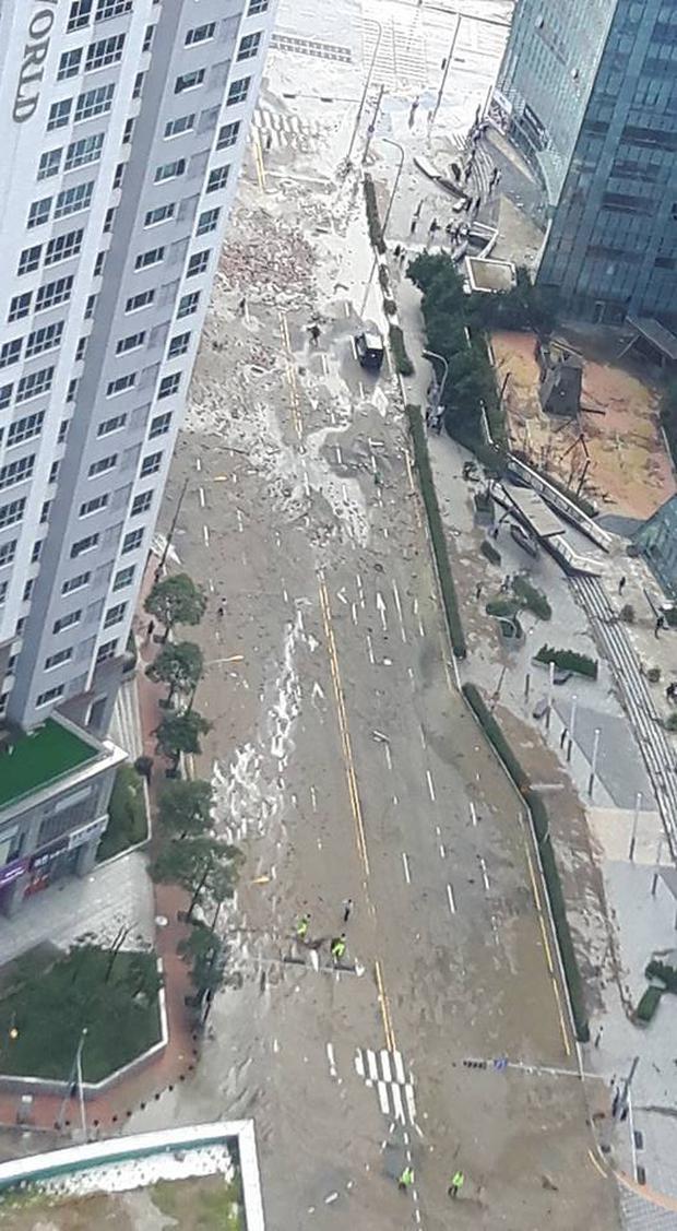 Cảnh tượng ngập lụt, đổ nát kinh hoàng sau bão tại siêu đô thị Busan của Hàn Quốc - Ảnh 14.