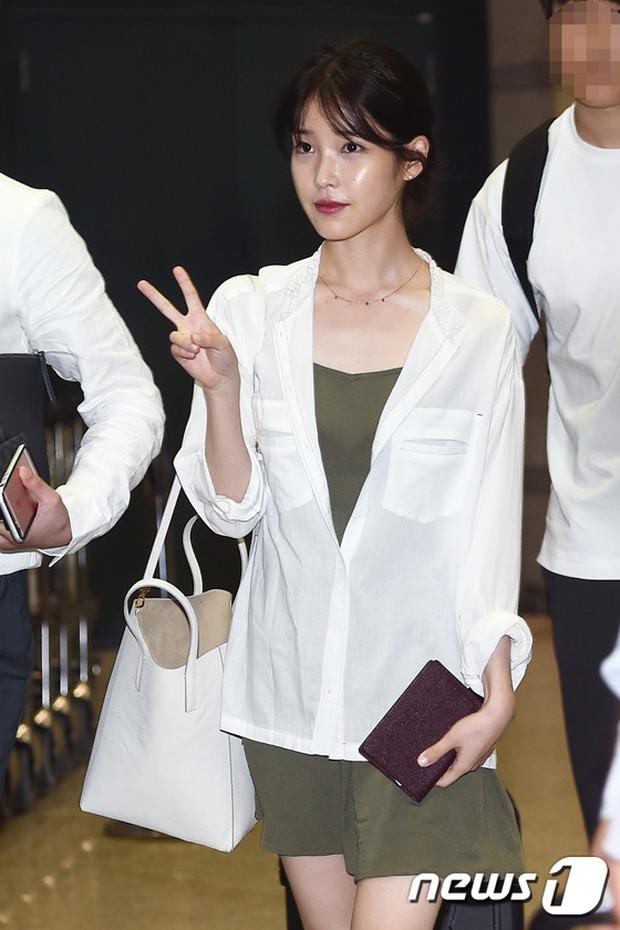Yoona (SNSD) thả dáng sang chảnh, IU bị tố làm mũi khi xuất hiện tại sân bay - Ảnh 2.