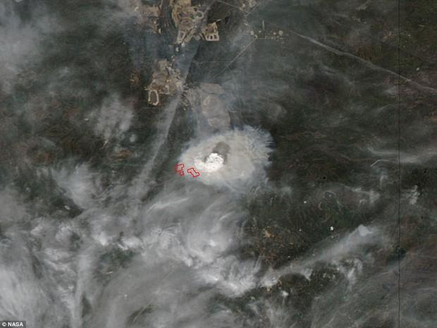Khung cảnh kinh hoàng của một trong những vụ cháy rừng tồi tệ nhất trong lịch sử Canada - Ảnh 17.
