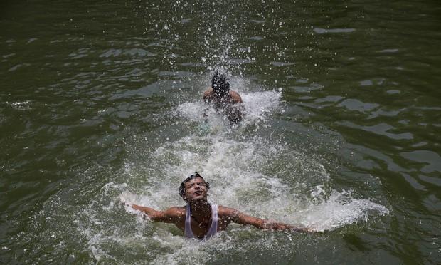 Nóng như hôm nay đã là gì, Ấn Độ còn đang nóng 51 độ C kìa - Ảnh 4.