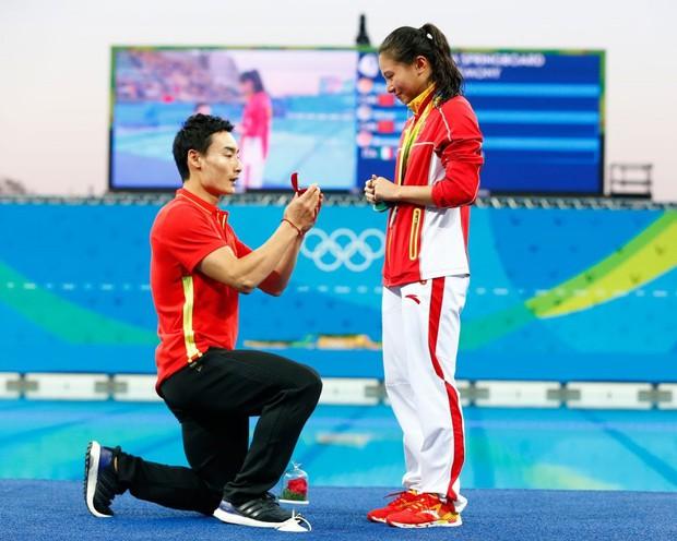 Những khoảnh khắc ngọt ngào và xúc động trên sàn đấu Olympic - Ảnh 8.