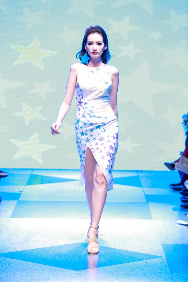 Thanh Hằng diện váy làm từ 25m vải lên sàn diễn của Adrian Anh Tuấn - Ảnh 23.