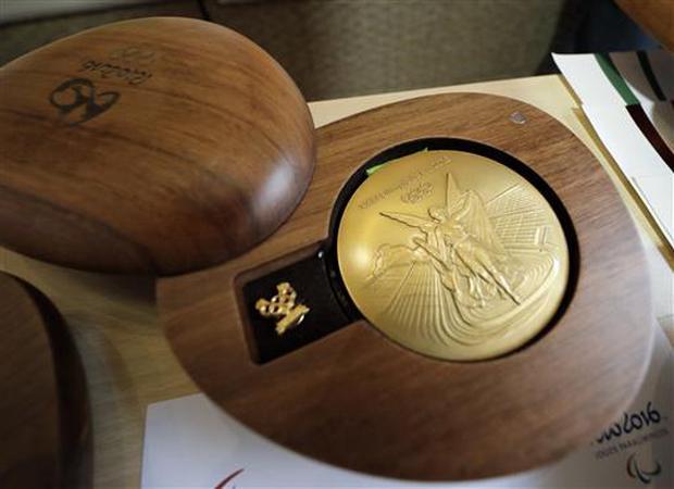 Một tấm huy chương vàng Olympic đã được sản xuất như thế nào? - Ảnh 1.