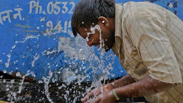Nóng như hôm nay đã là gì, Ấn Độ còn đang nóng 51 độ C kìa - Ảnh 1.