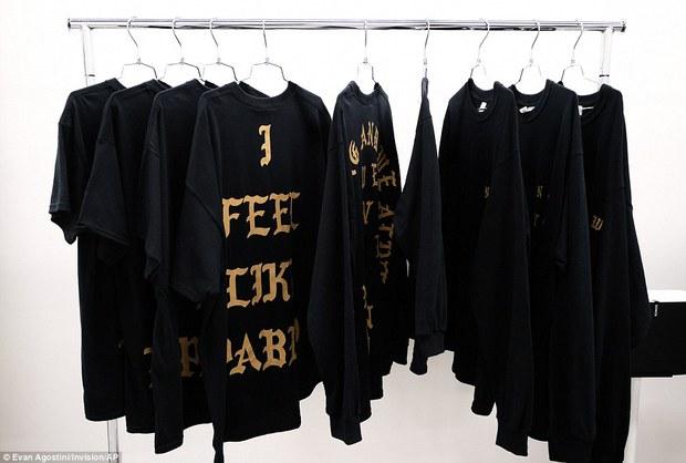 Fan khắp thế giới xếp hàng 15 tiếng, bất chấp mưa gió để mua đồ Kanye West thiết kế - Ảnh 13.