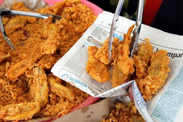 4 loại giấy gói thực phẩm có nguy cơ gây ngộ độc cao nhất - Ảnh 1.