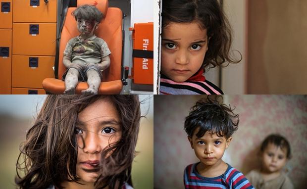 Em bé 5 tuổi bị không kích: Khi ánh mắt lạnh lẽo và dửng dưng trở thành biểu tượng chiến tranh - Ảnh 1.