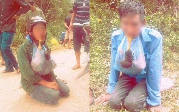 Người đàn ông trộm chó bị dân đánh nhốt vào cũi, nhất định không giao cho chính quyền - Ảnh 2.