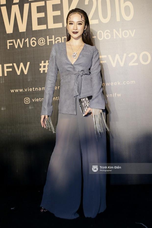 Và đây là 10 bộ cánh ấn tượng nhất trên thảm đỏ Vietnam International Fashion Week! - Ảnh 2.
