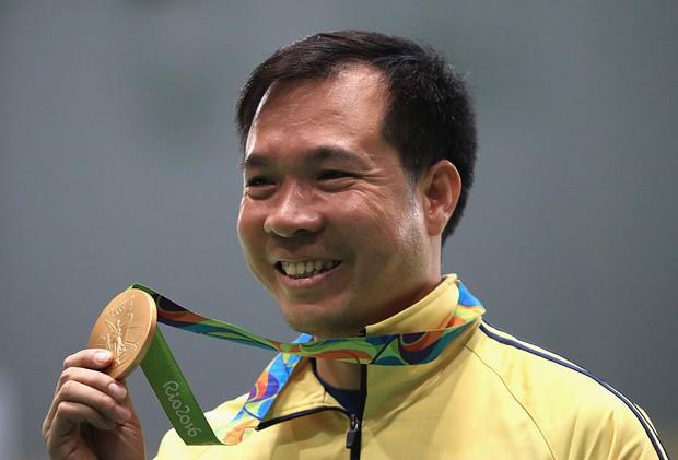 Xúc động khoảnh khắc quốc ca Việt Nam vang lên trên đỉnh Olympic - Ảnh 12.