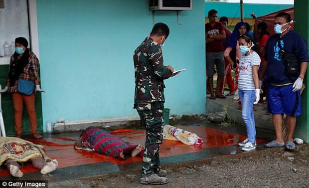 Trước khi đổ bộ vào Việt Nam, bão Tembin khiến hơn 200 người thiệt mạng và khoảng 153 người mất tích tại Philippines - Ảnh 10.