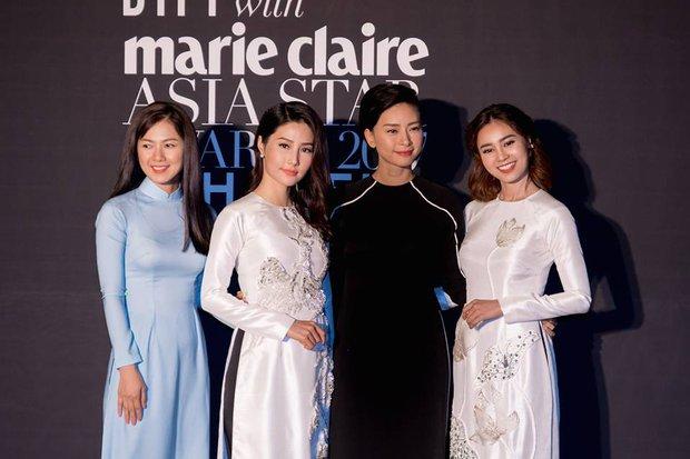 Đâu cần cầu kì hay hở bạo, chỉ cần mặc áo dài mà bộ tứ Cô Ba Sài Gòn cũng đủ gây ấn tượng tại LHP Busan - Ảnh 1.