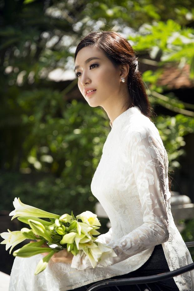 MC Phạm Mỹ Linh diện áo dài trắng, e ấp với hình ảnh thiếu nữ Hà Thành xưa - Ảnh 6.