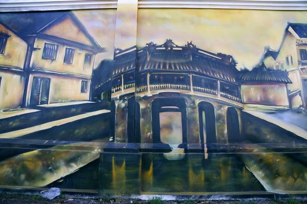 Bức tường cũ kỹ dài 60m bỗng biến thành những bức tranh phong cảnh quê hương 3 miền giữa Sài Gòn - Ảnh 8.