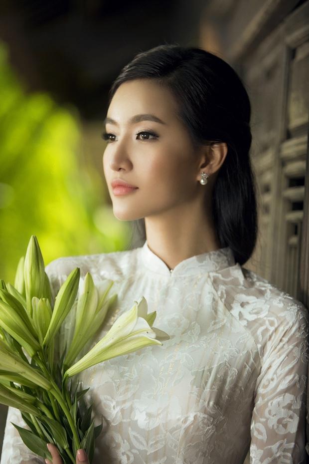 MC Phạm Mỹ Linh diện áo dài trắng, e ấp với hình ảnh thiếu nữ Hà Thành xưa - Ảnh 13.