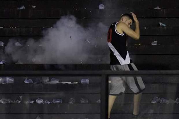 CĐV thiệt mạng sau cuộc bạo loạn kinh hoàng ở Brazil - Ảnh 6.