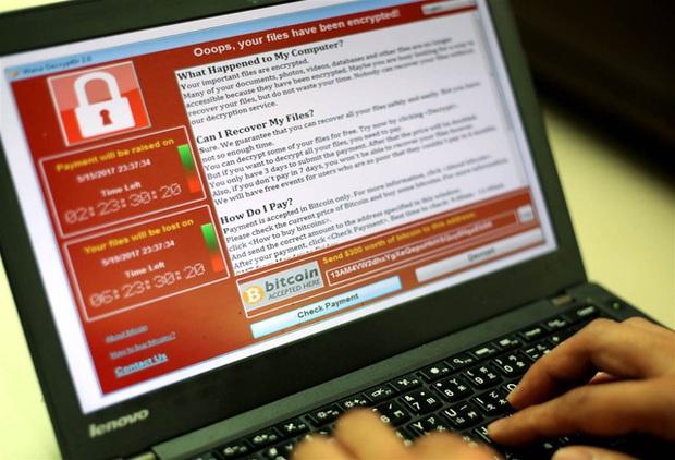 Máy tính bị nhiễm mã độc WannaCry, đây là những gì bạn cần phải làm - Ảnh 1.