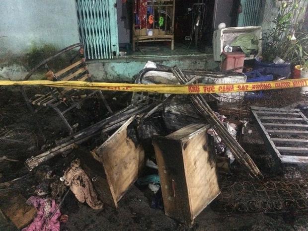 Cháy lớn ở Sài Gòn, bà và cháu gái 3 tuổi tử vong, ít nhất 4 người khác bị thương nặng - Ảnh 6.