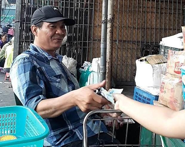 Nghi vấn bảo kê tại chợ Long Biên: Khởi tố vụ án cưỡng đoạt tài sản - Ảnh 2.