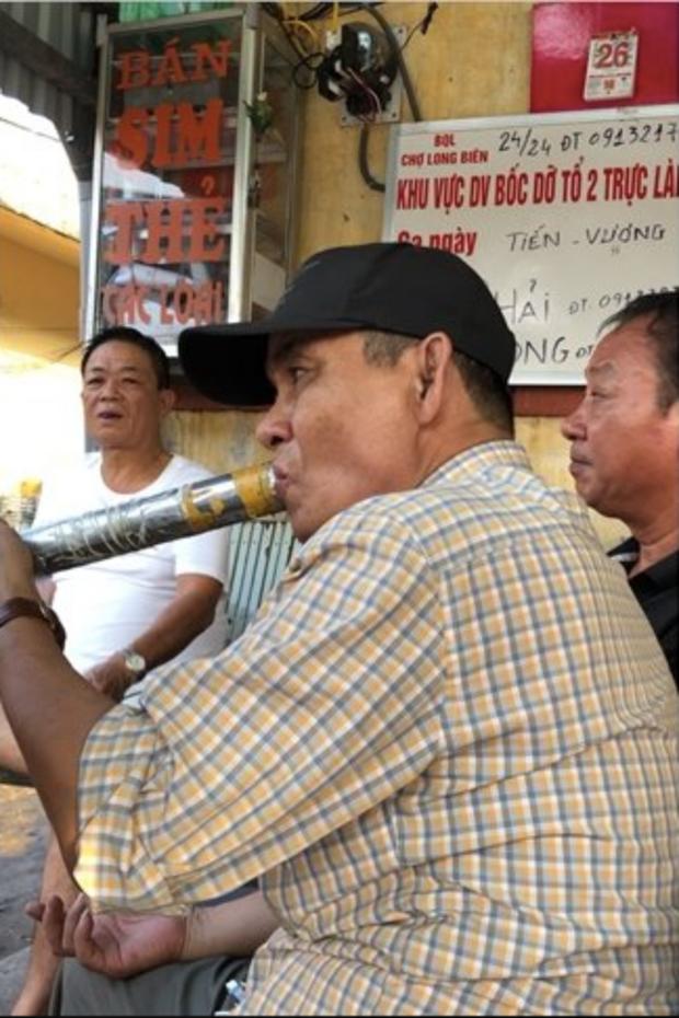 Nghi vấn bảo kê tại chợ Long Biên: Khởi tố vụ án cưỡng đoạt tài sản - Ảnh 3.